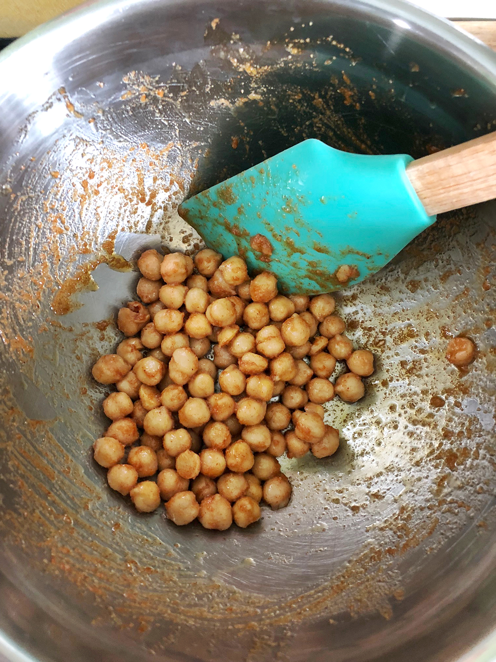 mixing-chickpeas-in-bowl