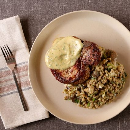 Pork Chops with Farro Risotto and Garlic Sauce